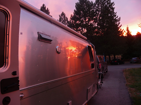 Sunset refected in side of Genevieve Airstream