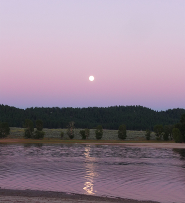 Full moon reflected in Lake Cascade