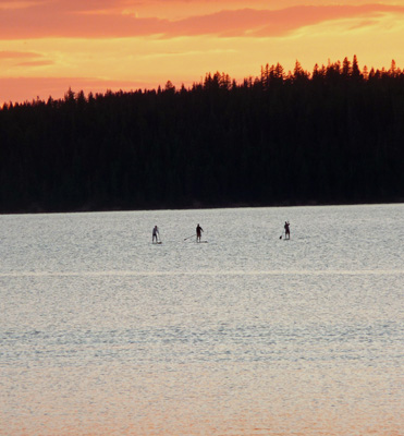 Paddle Boarders at sunset Paulina Lake OR